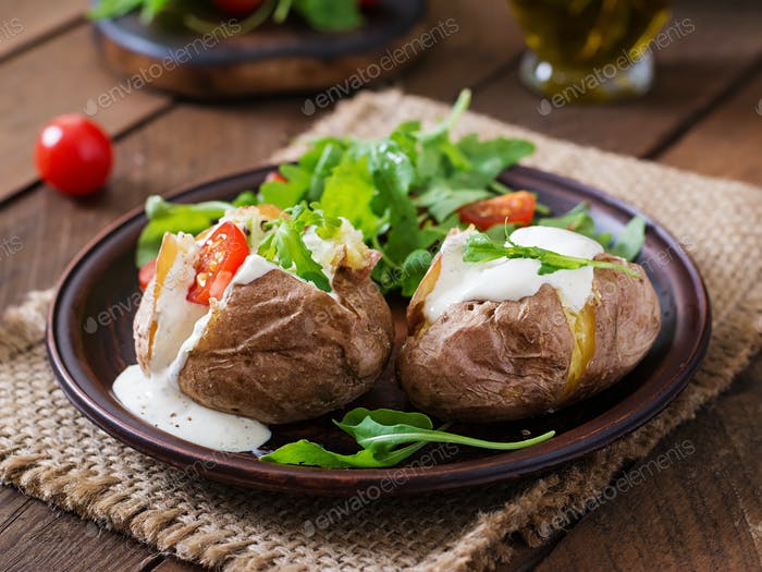 Baked potato filled with sour cream, arugula and tomatoes