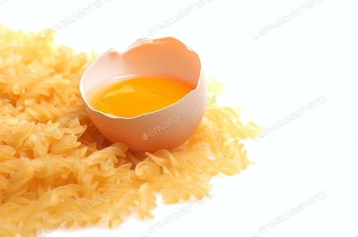 Broken egg and pasta.