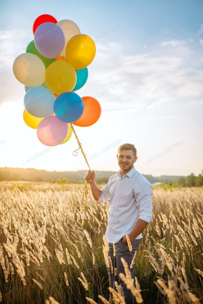 Man walks with bunch of balloons