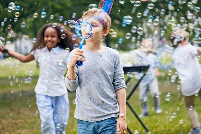Joyful Kids Making Soap Bubbles
