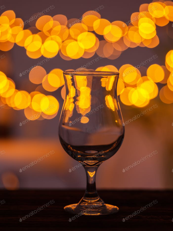 Empty glass on bar table