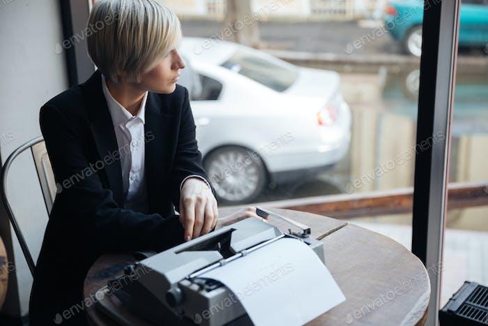 Blonde girl sitting in cafe