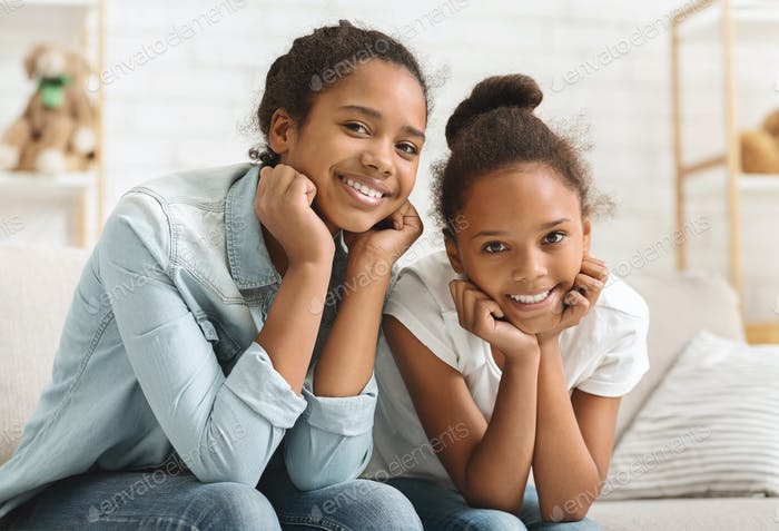 Adorable sisters having fun together at home
