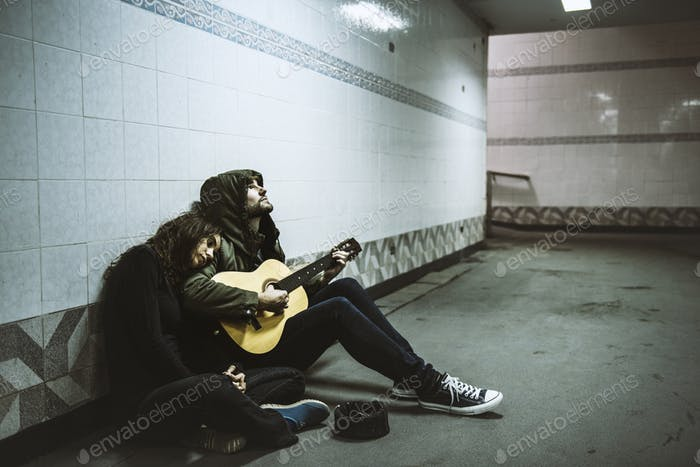 Homeless Couple Man Playing Guitar Asking For Money Donation