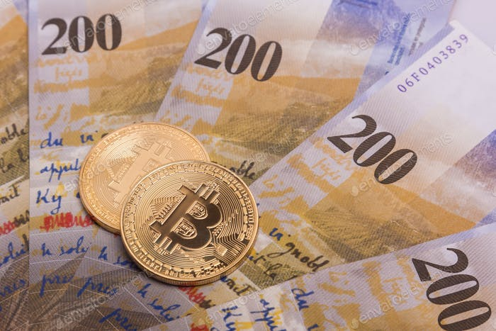 Bitcoin btc crypto currency coin over swiss francs bank notes
