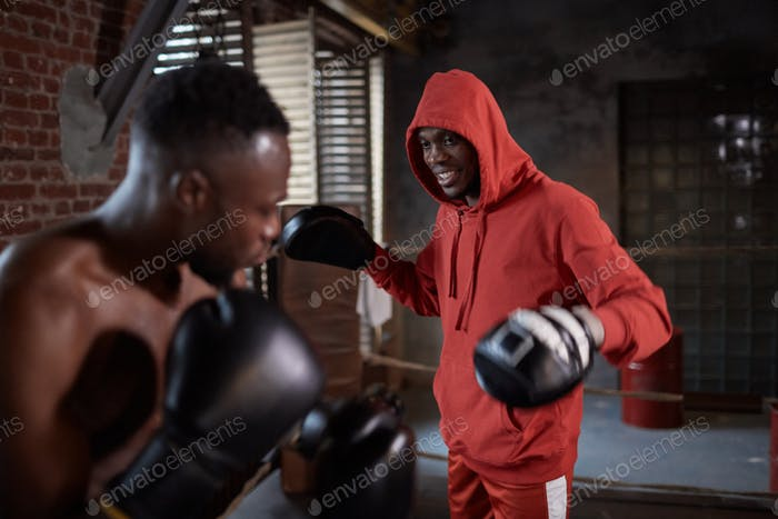 Boxers fighting in gym