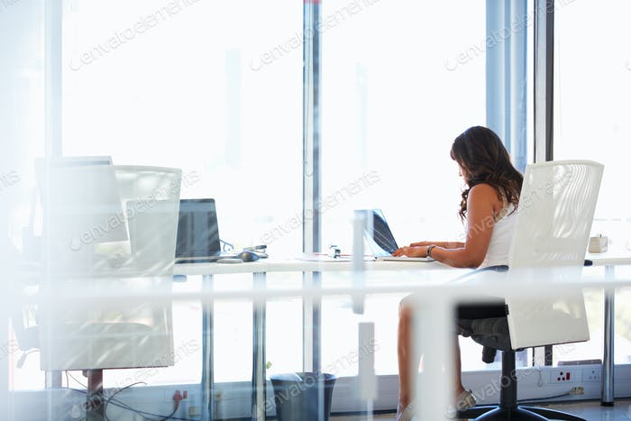 Woman working alone in an office