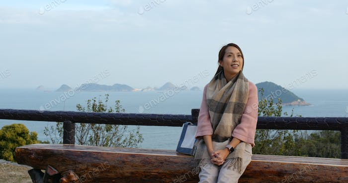 Woman look around the view with the seascape background