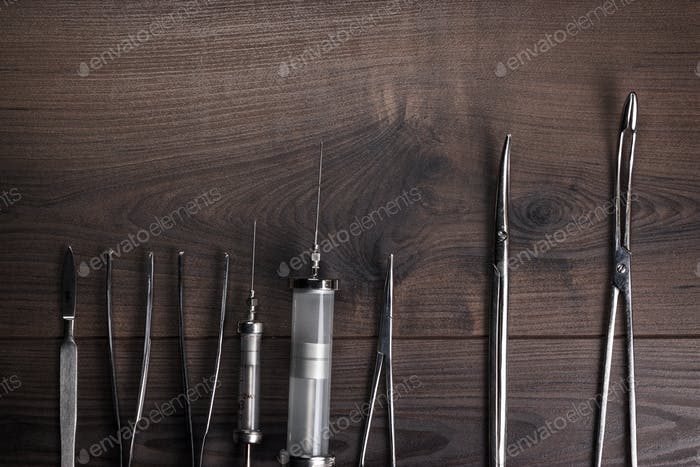 Surgical Armaments On The Wooden Table