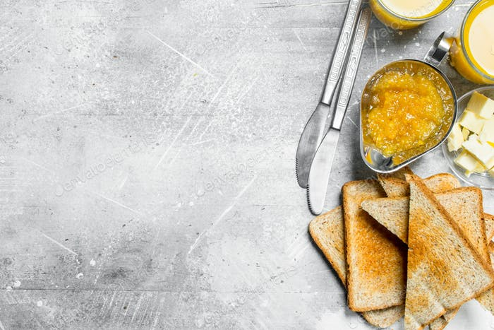 Toasted bread with butter and orange jam.
