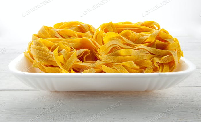 Italian tagliatelle pasta on a tray