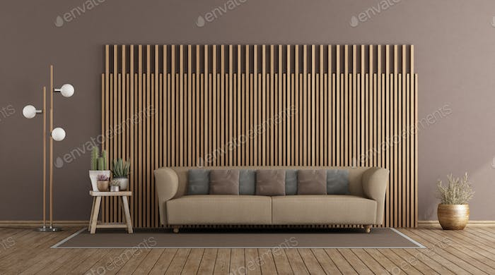 Living room with sofa and wooden paneling