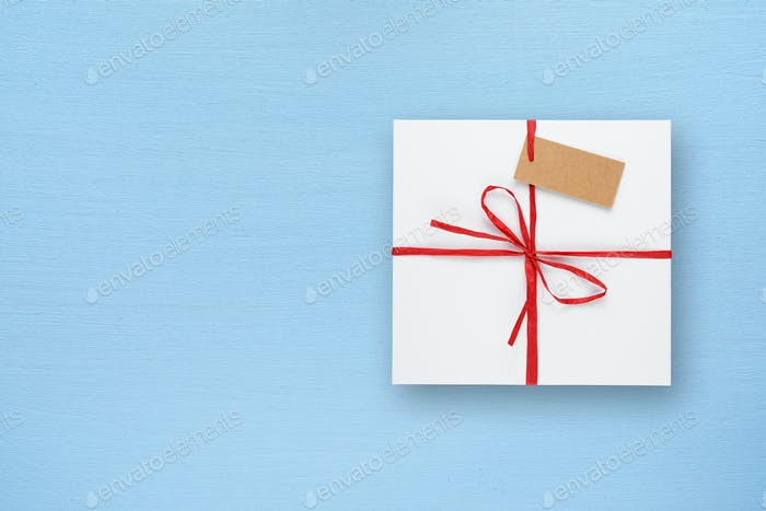 White gift box on blue table top view