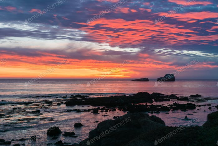 Dramatic sunset on the Pacific Ocean coastline near San Simeon, California