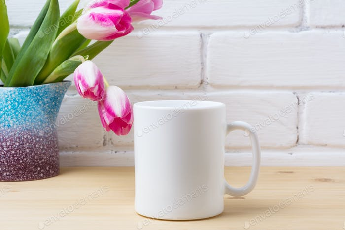 White coffee mug mockup with pink tulip in purple blue vase