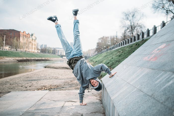 Hip hop performer, upside down motion on street