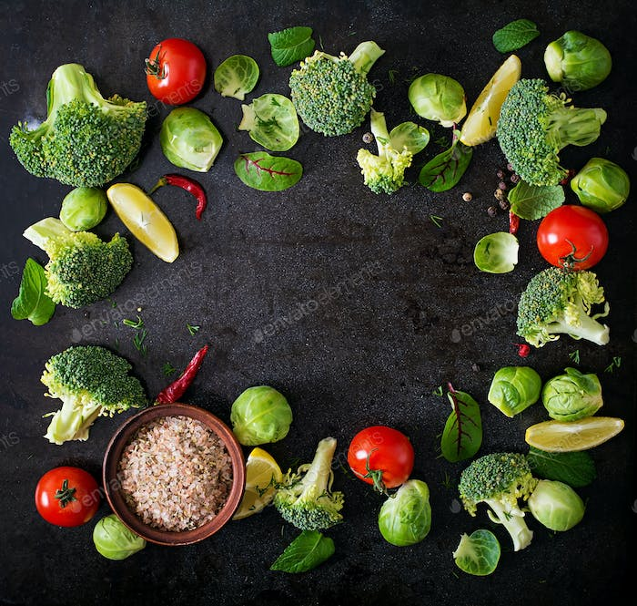 Fresh vegetables for a healthy diet on a dark background in a rustic style. Top view