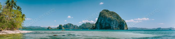 Tropical panorama scenery of coastline with huge rocky island on the background. National Marine