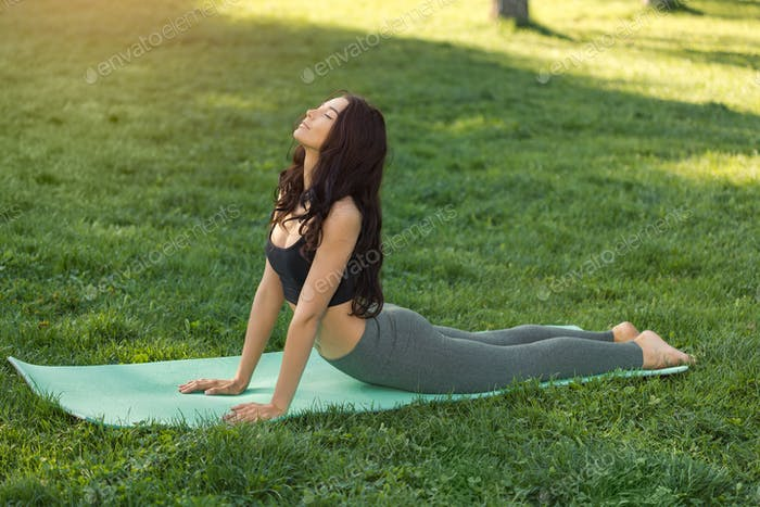 Woman Practicing Yoga Outdoors in Park