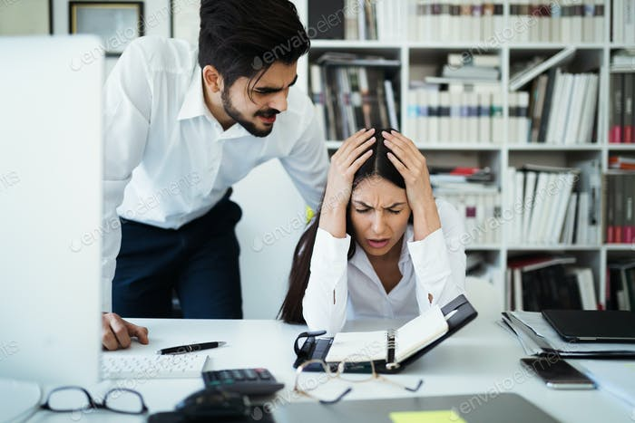 Angry irritated boss reprimanding employee afraid to be fired, bad work