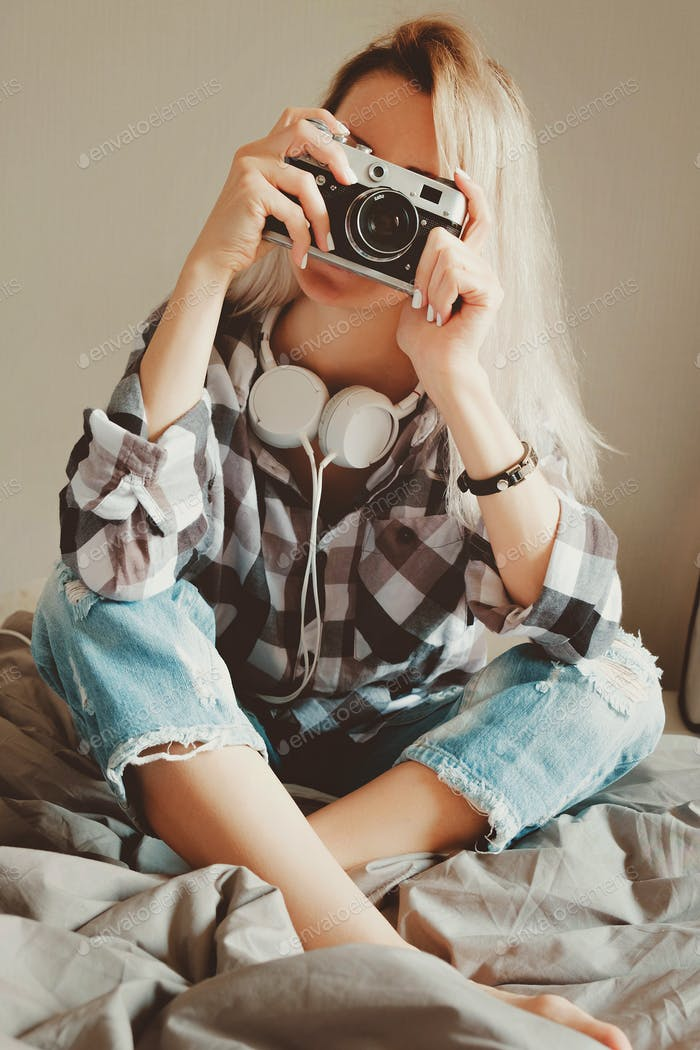 Young beauty female in casual shirt taking a picture