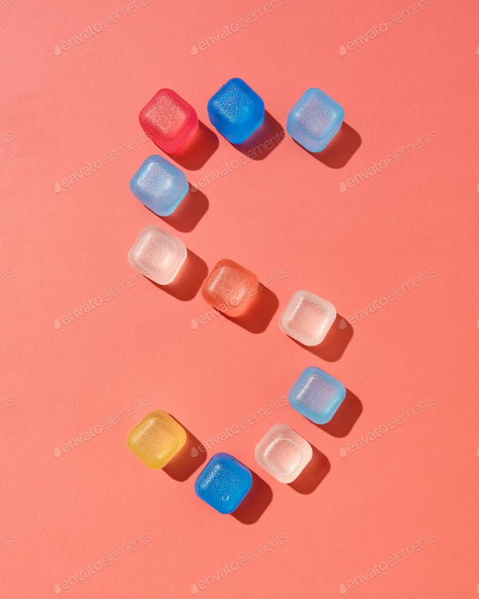 Figure five pattern from colored plastic ice cubes on a background in a color of the year 2019