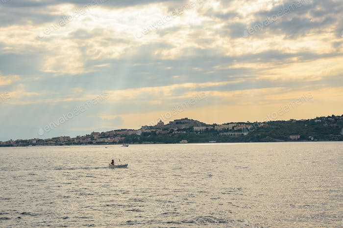 Milazzo town seen from the sea at sunset