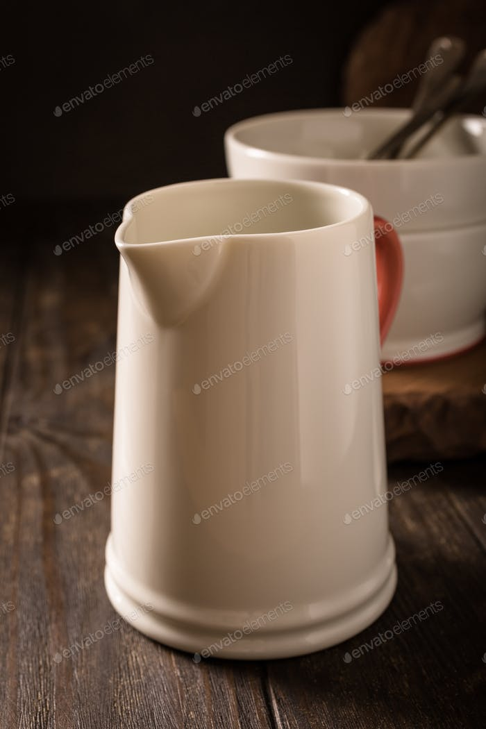 Ceramic white jug with red handle