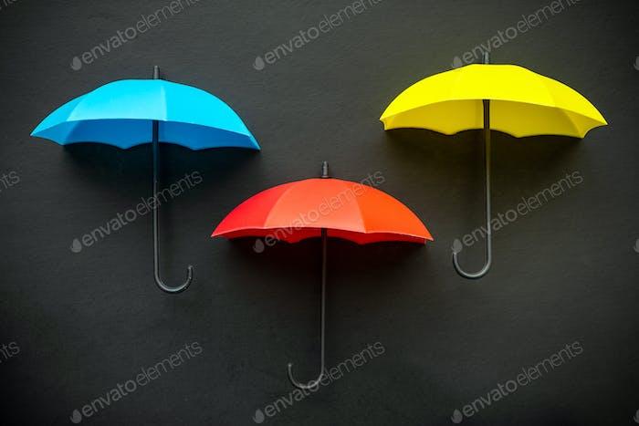 Three colors umbrella icon