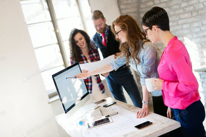 Creative young business people and architects working in office