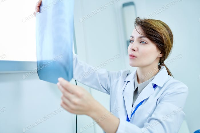 Doctor looking attentively at X-ray of chest