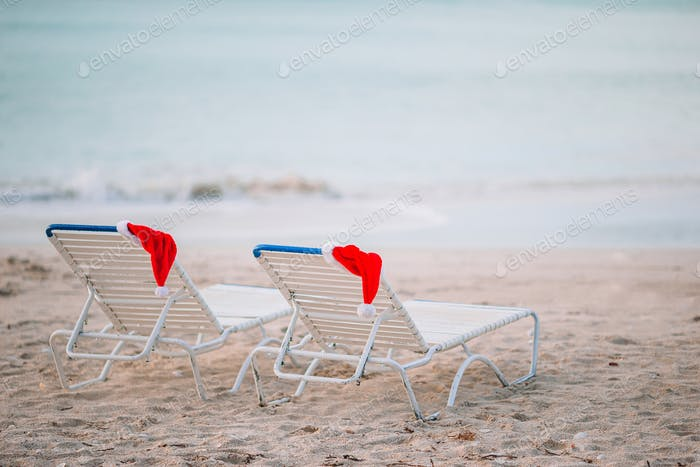 Closeup santa hat on chair on tropical white beach