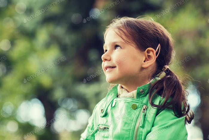 happy beautiful little girl portrait outdoors