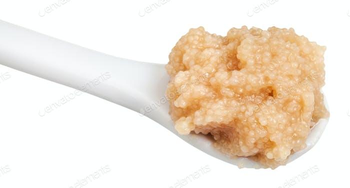 salty caviar of herring in ceramic spoon close up