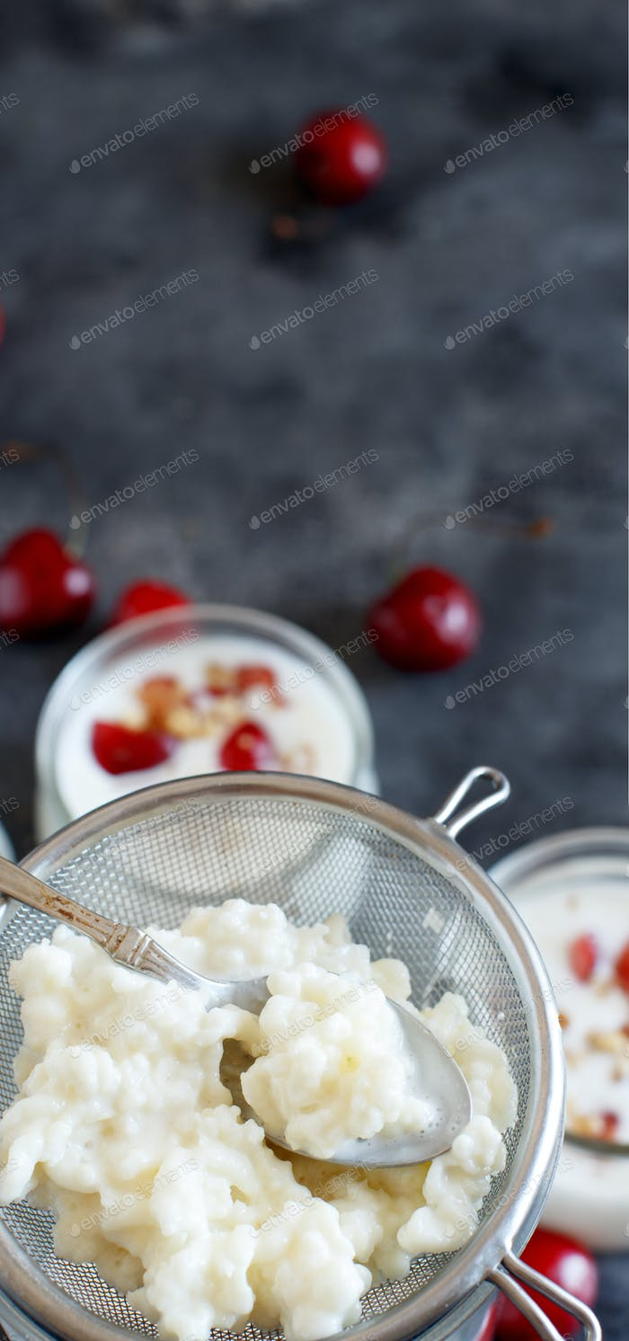 Fermented drink kefir and kefir grains with cherries and walnuts