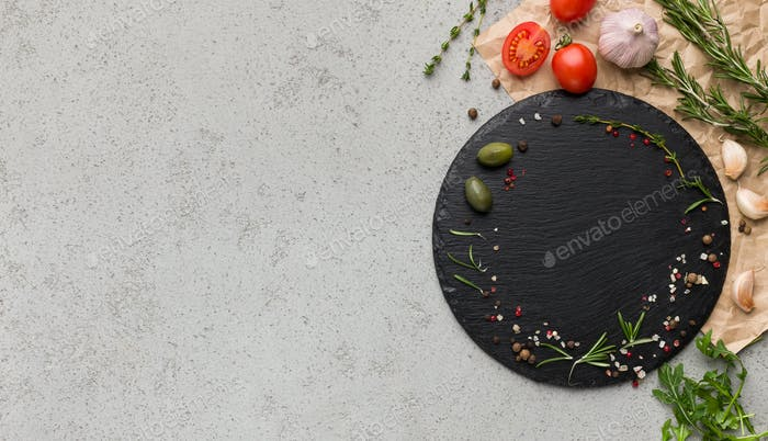 Empty board, spicies and vegetables on grey background