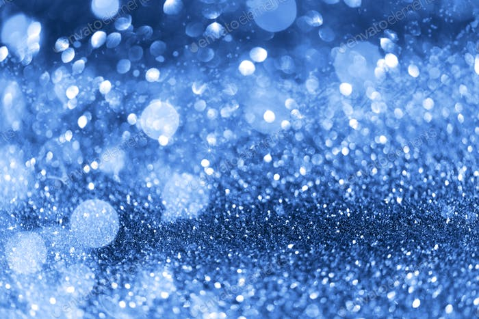 Holiday abstract texture. Christmas card with copy space. Сlassic blue background bokeh, defocused