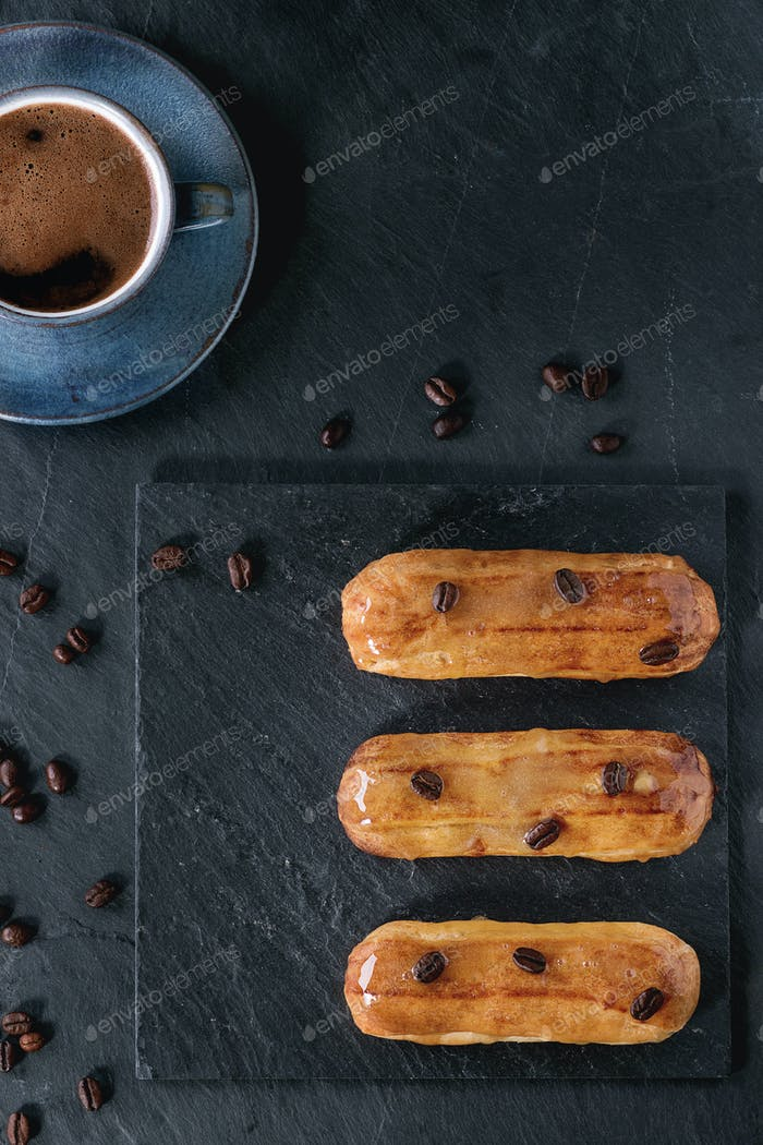 Coffe eclairs with cup of coffee