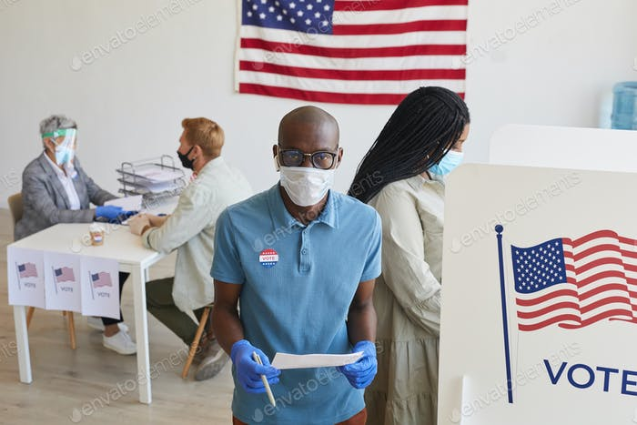 People Wearing PPE at Voting Station