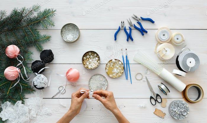 Creative diy hobby. Handmade christmas decoration, balls and garland