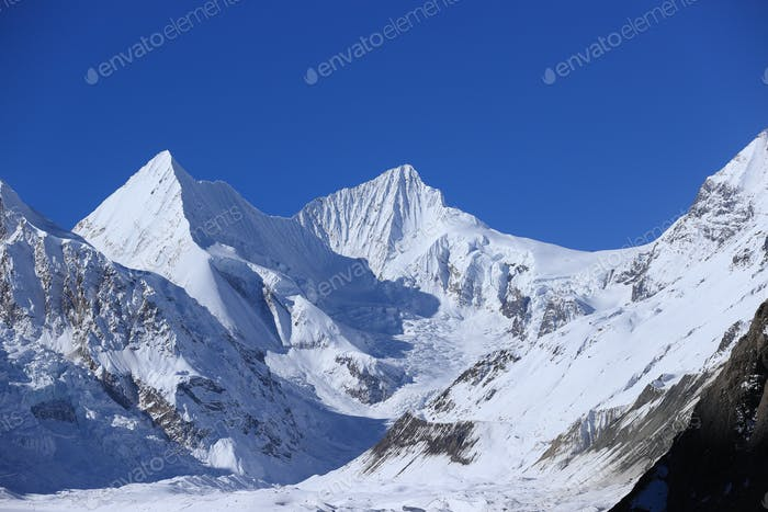 HikingSnow mountains under blue sky in tibet,China