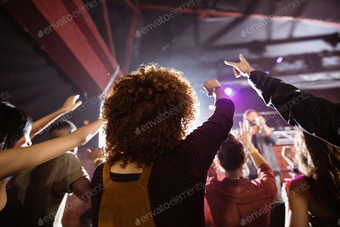 People enjoying music concert at nightclub