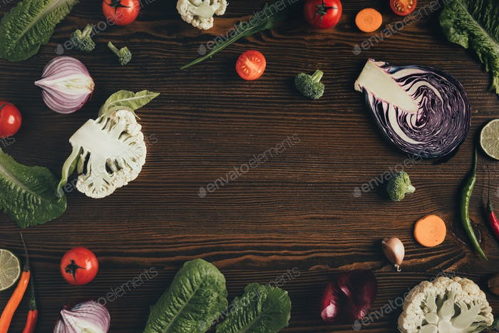 Top view of different vegetables on grungy surface