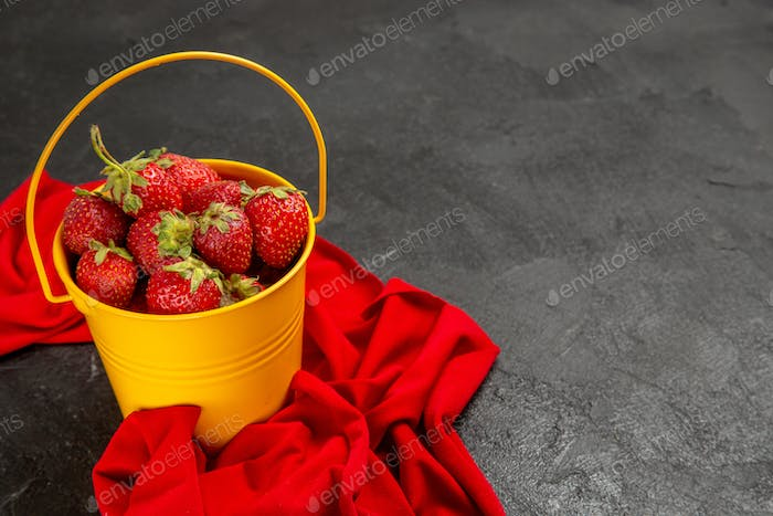 front view fresh red strawberries inside little basket on a dark background tree fruit berry