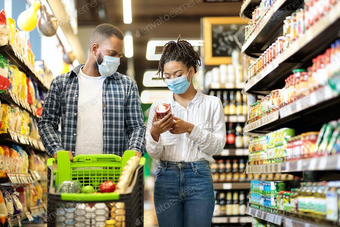 African American Couple In Masks Buying Groceries Food In Shop