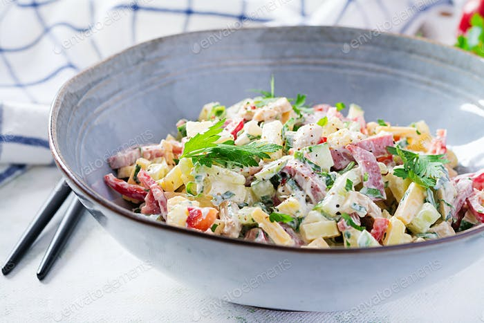 Salad with ham, paprika, cucumber and cheese.