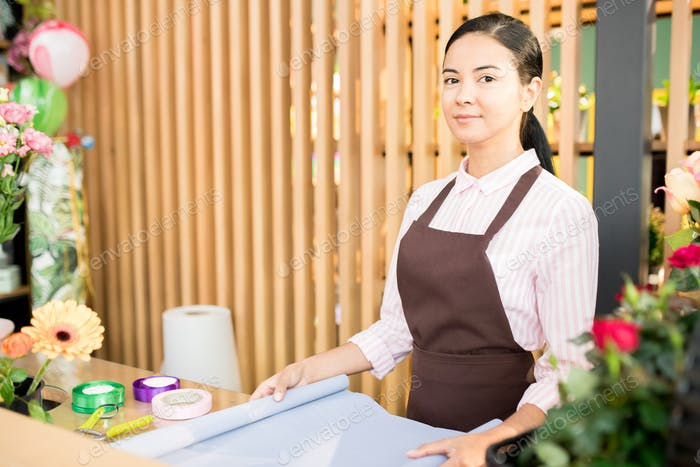 Young florist in apron