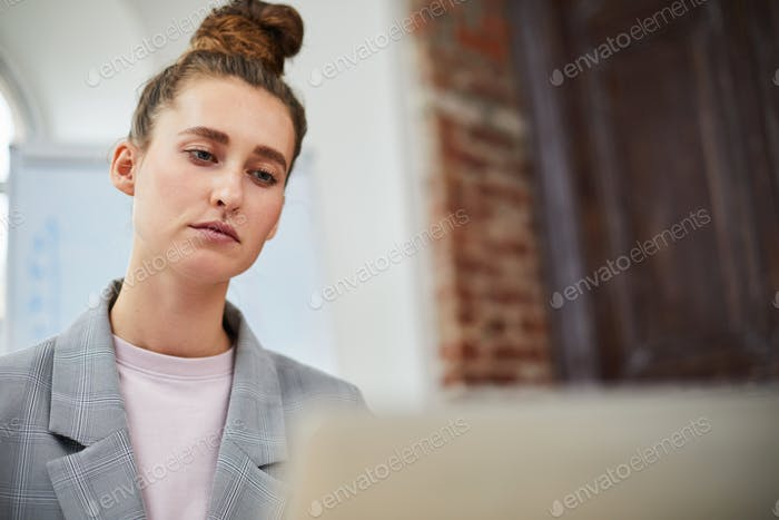 Contemporary Businesswoman Using Laptop in Office