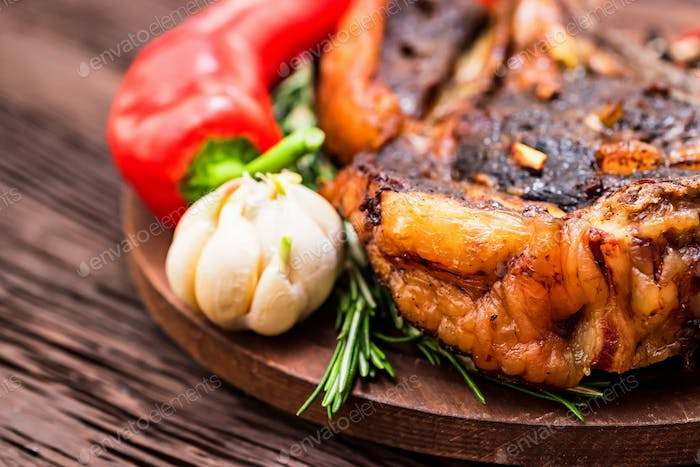 Tasty beef steak with spices and vegetables close