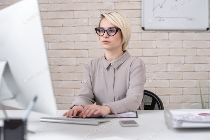 Businesswoman Working with PC in Modern Office